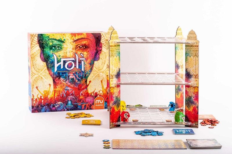 Pudełko i zawartość gry planszowej Holi. Festiwal kolorów