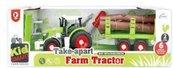 Traktor z przyczepą i drewnem do skręcania