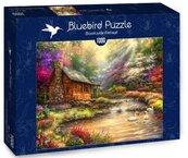Puzzle 1000 Piękna chata nad potokiem